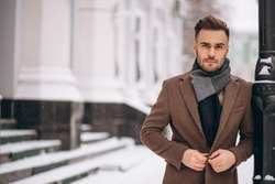 Handsome young business man outside in winter