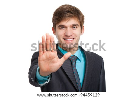 Handsome young business man showing stop gesture, businessman happy smile hold hand palm, wear elegant suit and tie isolated over white background.