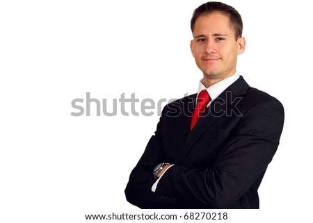 Handsome young business man smiling with his arms crossed