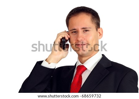 Handsome young business man talking on his mobile phone