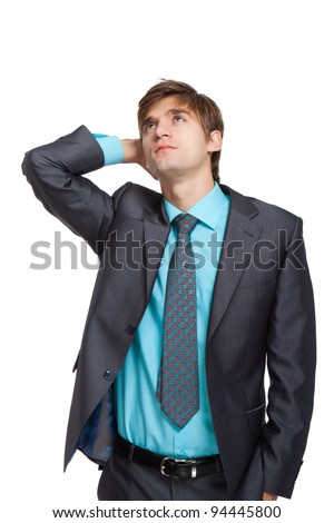 Handsome young business man think looking up corner to empty copy space, businessman hold hand behind head, wear elegant suit and tie, concept of advertisement product isolated over white background