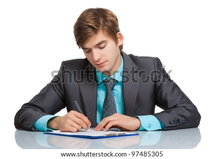 Handsome young business man writing, businessman working with documents sign up contract, sitting at the desk at office, wear elegant suit and tie isolated over white background