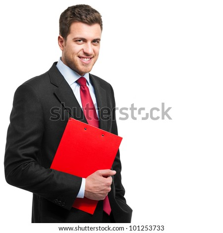 Handsome young businessman holding a clipboard isolated on white