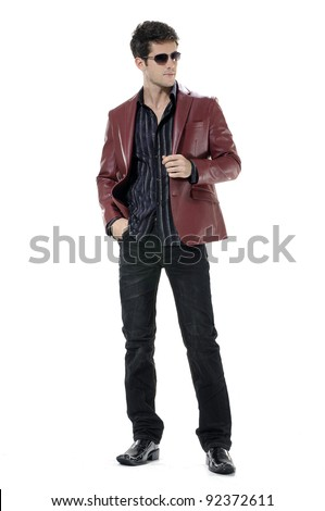 Handsome young businessman in sunglasses. Full body isolated