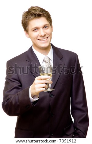 Handsome young businessman with a glass of champagne