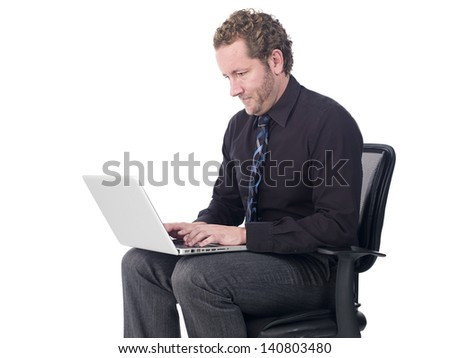 Handsome young doctor working on a laptop over white background