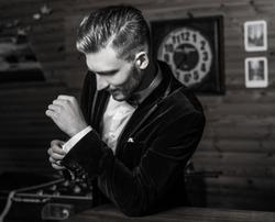 Handsome young elegant man pose against house interior. Black-white portrait.