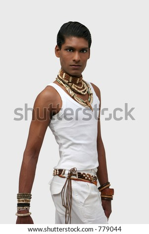 Handsome young exotic man, in White vest-top with ethnic beads and necklaces
