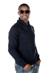 Handsome young fashionable attractive african man wearing sunglasses, a dark blue jersey and jeans.