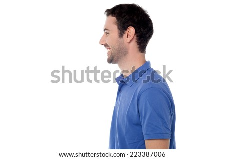 Handsome young guy posing, side view