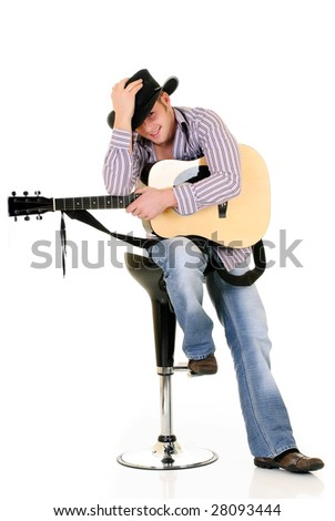 Handsome young male country & western singer, performer with guitar.  Studio shot, white background.