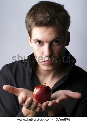 Handsome young male model holding an apple