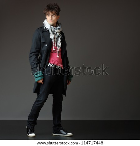 handsome young male model posing - studio shoot - copy space