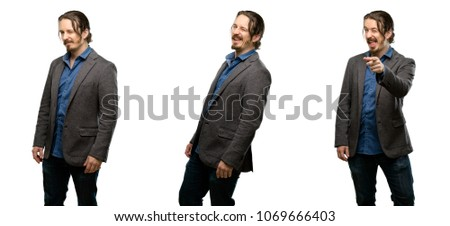 Handsome young man blinking eyes with happy gesture