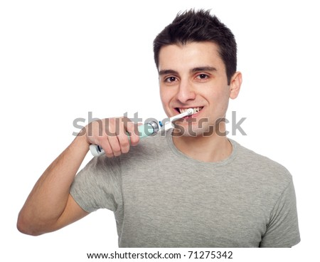 handsome young man brushing his teeth with electric toothbrush (isolated on white background)