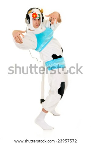 Handsome young man dressed up as  mad hip hop culture cow.  Studio, white background.