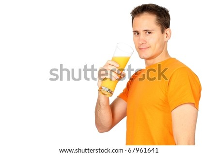 Handsome young man drinking orange juice with lots of copyspace