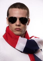 Handsome young man English wearing flag scarf