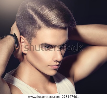 Handsome young man. Fashion young model man portrait. Handsome Guy. Vogue style image of elegant boy. fashion Hairstyle, haircut.