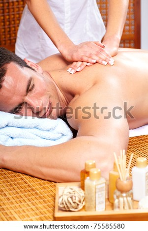 handsome young man getting spa massage. Relax.