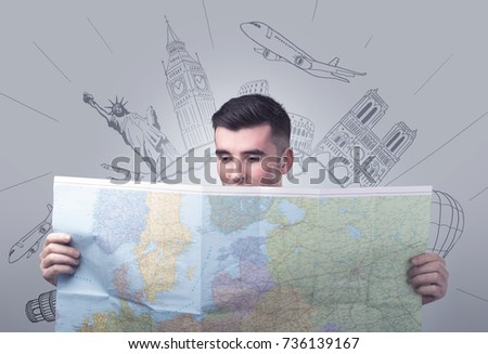 Handsome young man holding a map with famous sightseeing destinations above his head #736139167