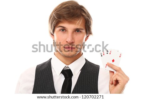 Handsome young man holding playing cards in hand