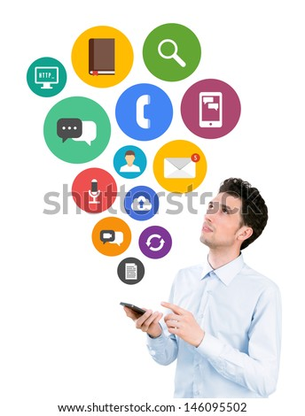 Handsome young man holding smartphone and looking on collection of colorful mobile application icons in flat design on communication and mobile connection theme. Isolated on white background.