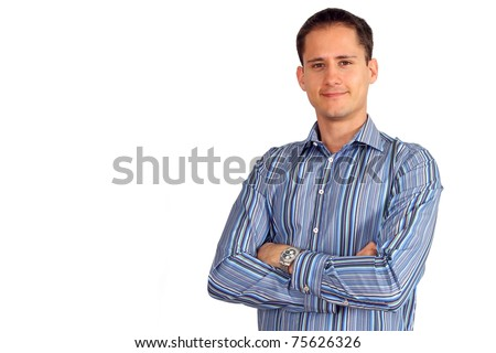 Handsome young man in a multicolored shirt with his arms crossed