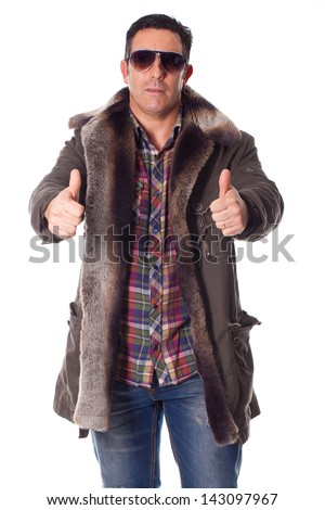 Handsome young man in a winter clothing with positive attitude