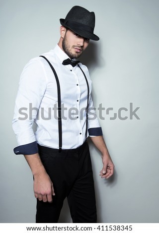 Free Photos Handsome Young Man In White Dress Shirt Wearing Hat Bow