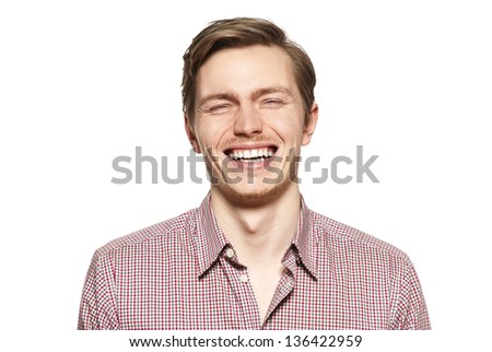 Handsome young man isolated over white. Funny face.
