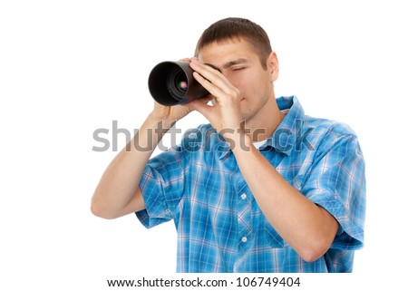Handsome young man looking through a telescope isolated on a white background - stock photo