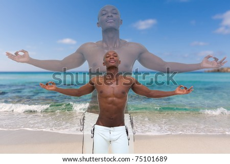 handsome young man meditating on the beach