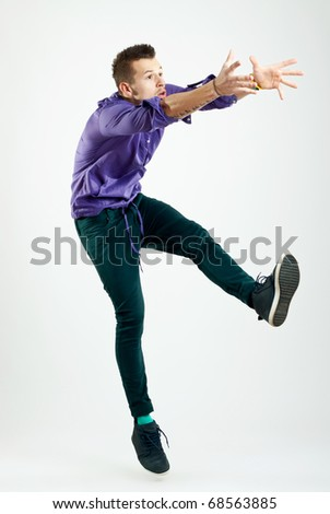 handsome young man model jumping  - studio shot