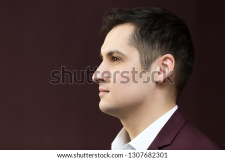 Handsome young man of 25-30 years old in a suit
