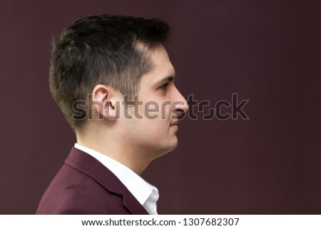 Handsome young man of 25-30 years old in a suit  .