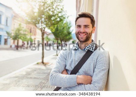 Handsome young man on a walk in town #348438194