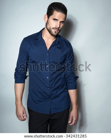 handsome young man posing in dress shirt #342431285