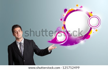 Handsome young man presenting abstract speech bubble copy space