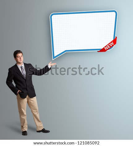 Handsome young man presenting modern speech bubble copy space
