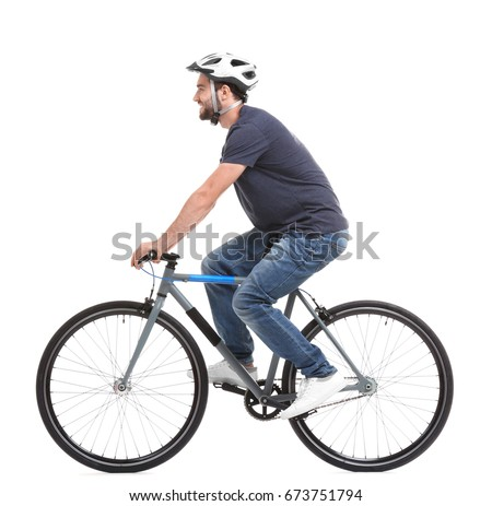 Handsome young man riding bicycle on white background