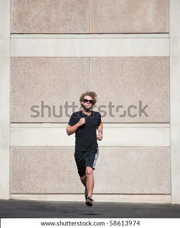 Handsome, young man runs for exercise.