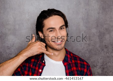 Handsome young man showing with fingers gesture