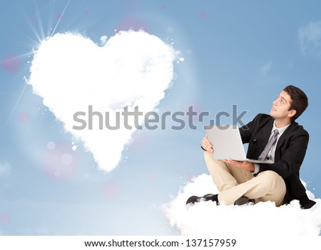 Handsome young man sitting on cloud with heart