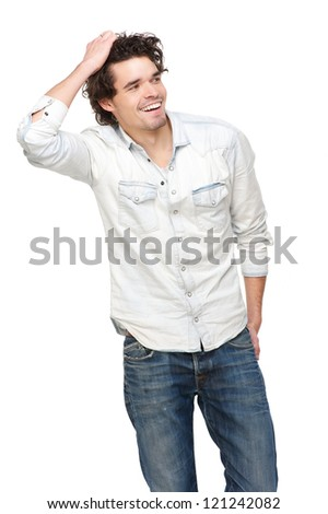 Handsome young man smiling and hand in his hair. Isolated on white background