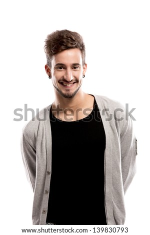 Handsome young man smiling, over a gray background