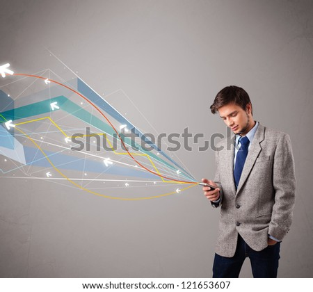 handsome young man standing and holding a phone with colorful abstract arrows and lines