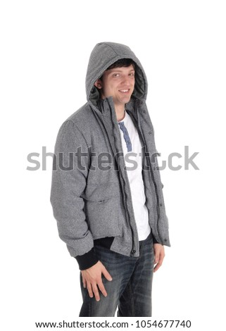 Handsome young man standing halve length in a gray jacket with a hoody andjeans, isolated for white background Stockfoto ©