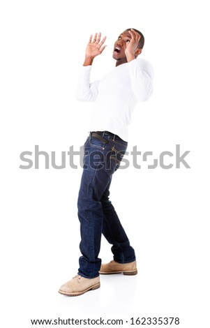 Handsome young man standing, scared. Isolated on white.