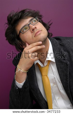 Handsome young man thinking about the future - stock photo